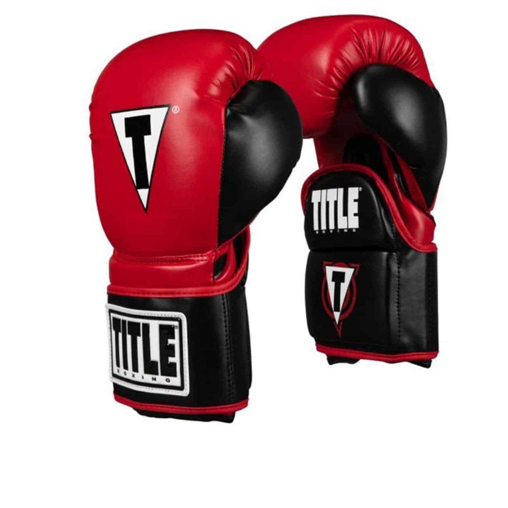 Coachhandske för boxning, fungerar som en mitts men också som en vanlig boxningshandske. Tillverkad i PU med kardborrelåsning