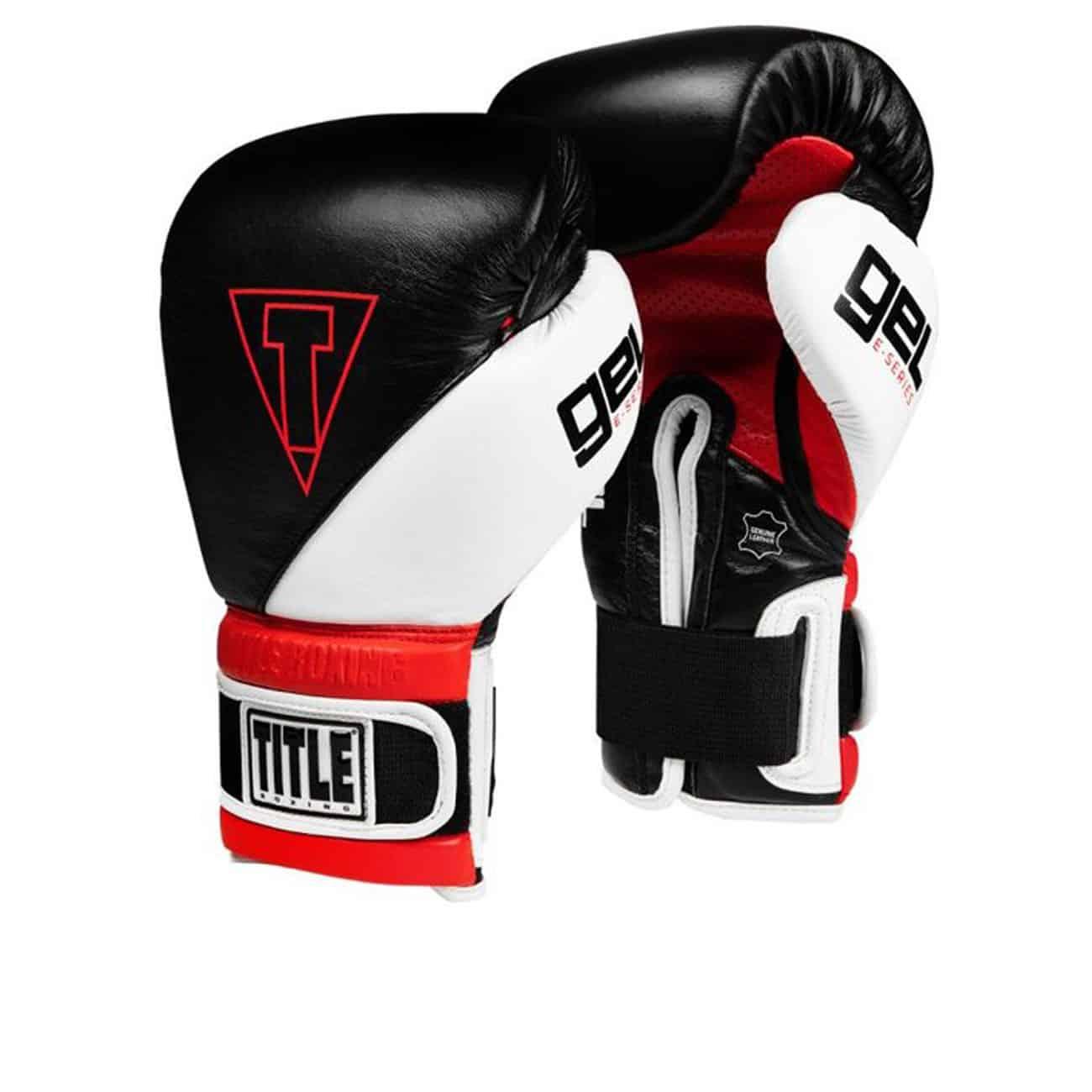 Boxningshandskar i läder, svart ovansida och vita och röda detaljer. Gel stoppning och kardborrelåsning